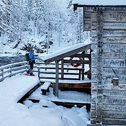 A snowshoer by the Myllykoski Rapids. Photo: Sanna Saarela