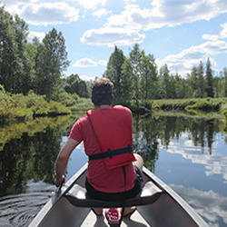 Enjoy Pärjänjoki River with a canoeing trip. Photo: Jenni Jelkänen
