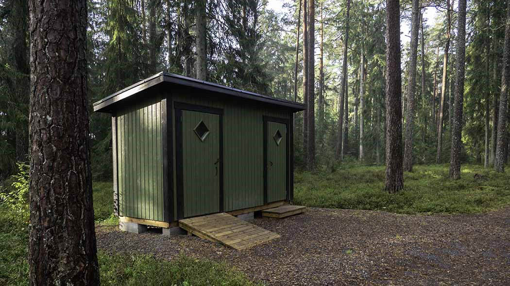 A composting toilet in the forest.